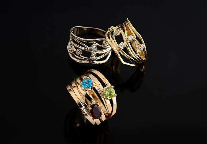 180-330 Golden Odyssey 14K Gold 0.15ctw Diamond Scattered Ring 180-333 Golden Odyssey 14K Gold 1.11ctw Blue Topaz, Garnet & Peridot Highway Ring